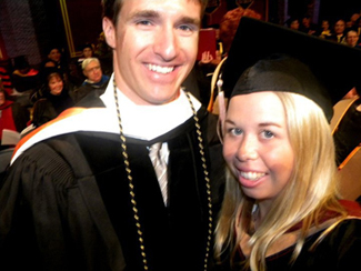 Brooke Ski Neal poses with Saints quarterback Drew Brees at Loyola commencement