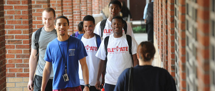 Elevate students on walkway in front of Carrollton Hall