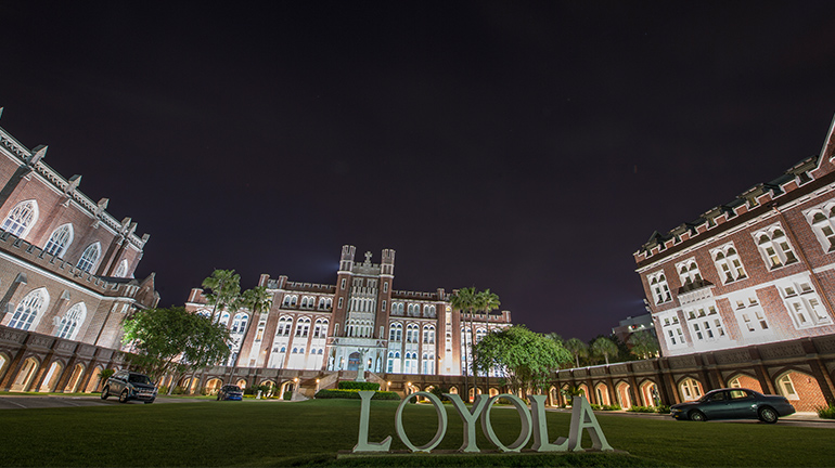 Monumental shot of Marquette Hall against night sky
