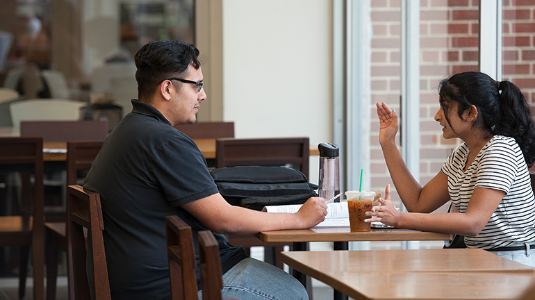 STudents discussing at Danna Center table