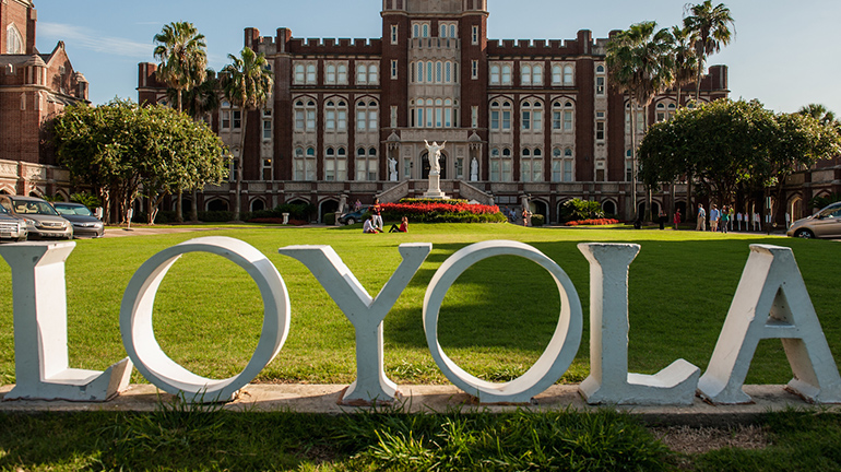 Marquette hall letters spelling out Loyola