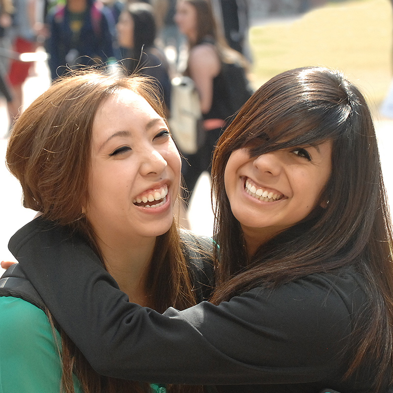 Close up of two female friends hugging