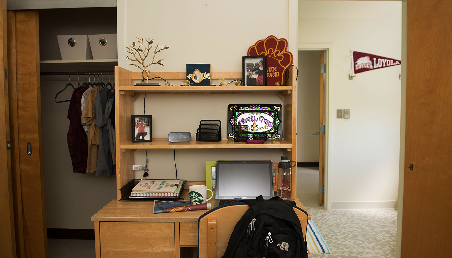 View of desk space and hallway in dorm