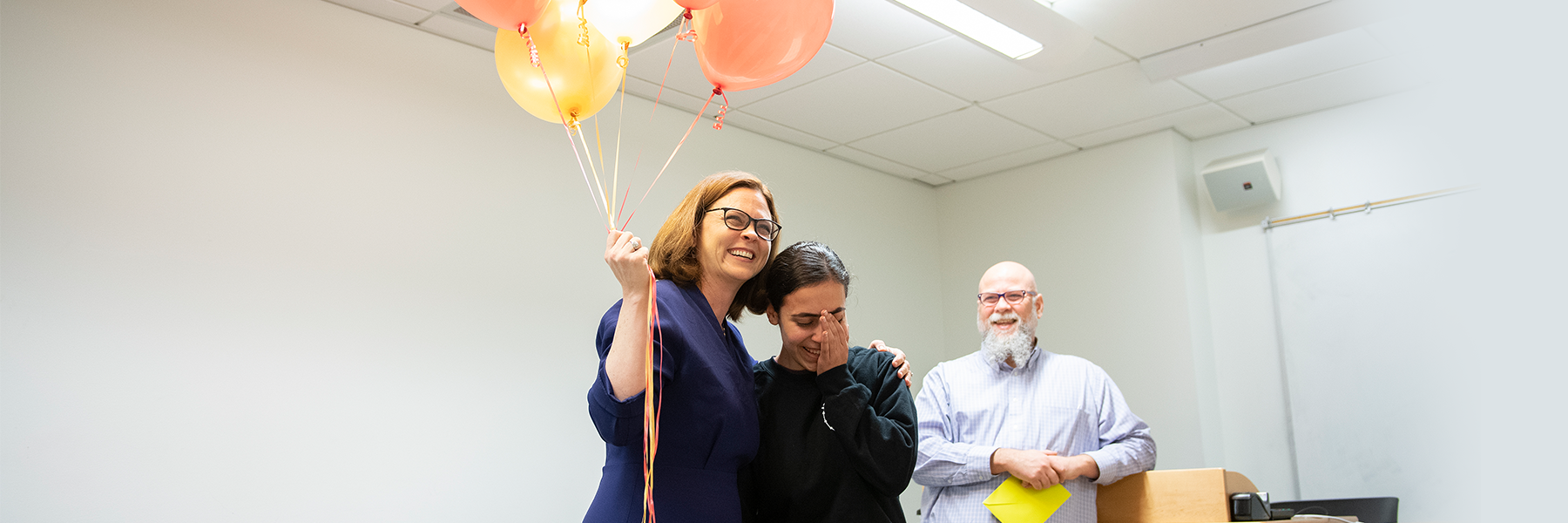Rana receives Truman Fellowship and balloons from President Tetlow