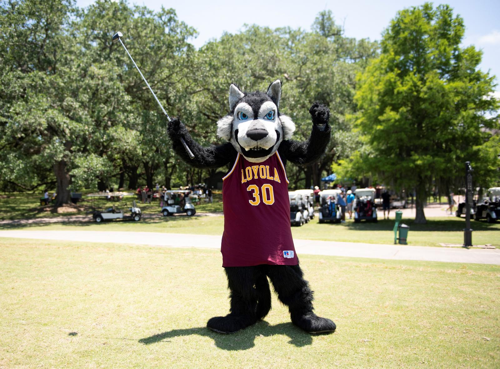 Photo of Loyola mascot playing golf