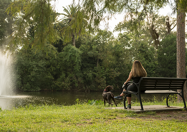 Girl and dog in Audubon Park